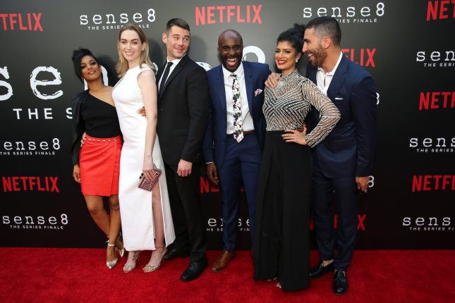 "Freema Agyeman, Jamie Clayton, Brian J. Smith, Toby Onwumere, Tina Desai and Miguel Angel Silvestre seen at the screening of Netflix Original Series ""Sense8"" Finale at the ArcLight Hollywood on Thursday, June 7, 2018, in Los Angeles. (Photo by Blair Raughley/Invision for Netflix/AP Images)"